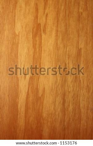 Warmly-lit wood grain.