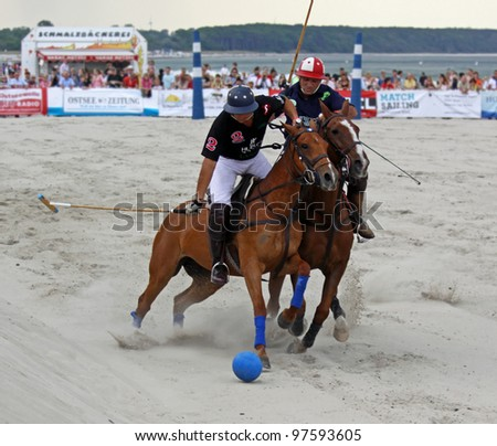 "WARNEM�NDE, GERMAN - MAY 22: Hugo Iturraspe and Comanche Gallardo compete in the semifinal of the ""Beach Polo Baltic Cup Warnemãnde"" on the beach of Warnemãnde, Germany on May 22, 2011."