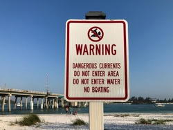 Warning Dangerous Current Sign on a Manatee County Florida Beach
