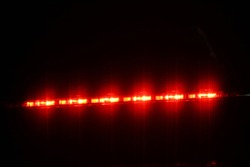 warning light car, brake light, hazard lights Night light effect background soft blurry on black for flash colorful designs pace glow