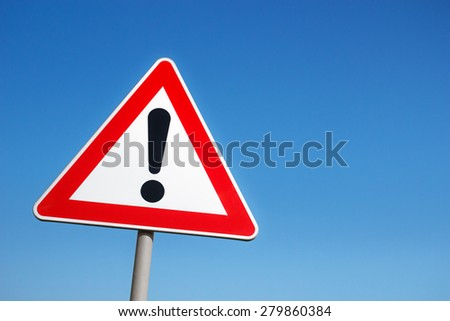 Warning road sign against a blue sky. #279860384