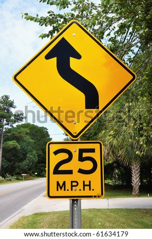 Warning road sign, Curve ahead 25 M.P.H.