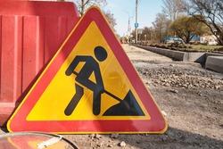 Warning road sign, road works in progress