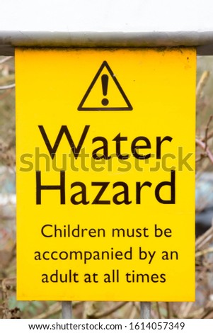 Warning sign about a water hazard where children should be accompanied at all times
