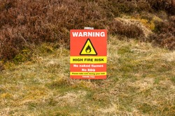 Warning sign about the high risk of fires on tinder dry Grouse Moors in the Yorkshire Dales, UK. Fires cause  destruction to wildlife including rare ground nesting birds. Horizontal.  Space for copy.