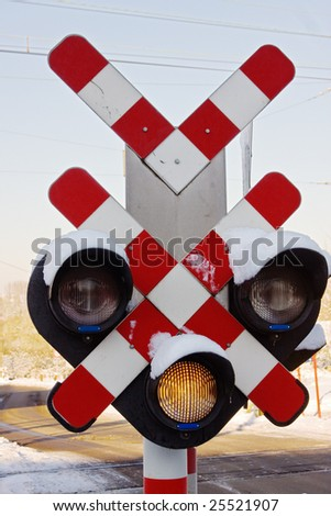 Warning sign and traffic light at railroad crossing