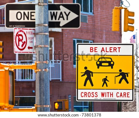 Warning sign at a dangerous, confusing and busy cross-walk.