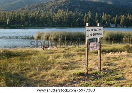 Warning sign at a wildlife preserve; Big Bear Lake, California