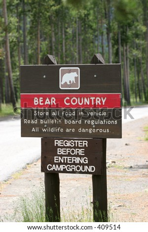 "warning sign at the entrance of a campground - ""bear country"" advisory.  yellowstone national park, wyoming"
