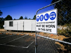 Warning sign construction site for must be worn this protective equipment on this site.