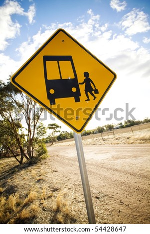 Warning sign for a bus stop in rural area.