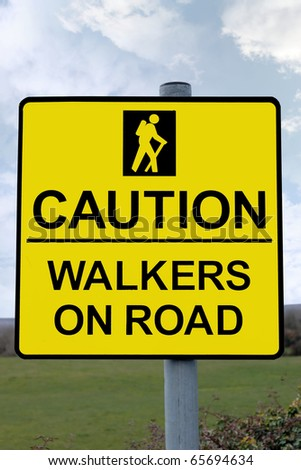 warning sign for drivers to be careful of tourists walking on country roads with clipping path