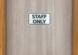 Warning sign in front of the door with a message for staff only