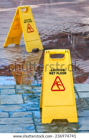 Warning sign in yellow with caution wet floor and the floor is get wet.