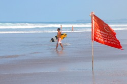 warning sign of a red flag at a beach