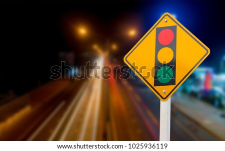 Warning sign of red light isolated from the background of the car line blur. #1025936119