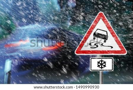 Warning Sign - Snow Storm - Slippery Road - 3D illustration