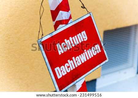 warning sign, warning roof avalanches, symbol photo for accident risk, safety and risk management