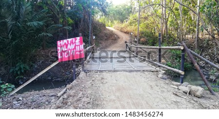 "warning signs ""beware of slippery roads"" when trying to cross an emergency bridge #1483456274"