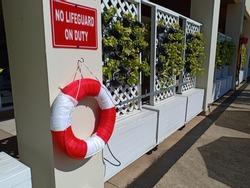 warning signs board No lifeguard on duty at pool