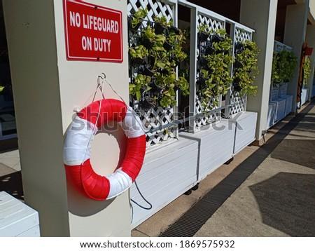 warning signs board No lifeguard on duty at pool Stockfoto ©