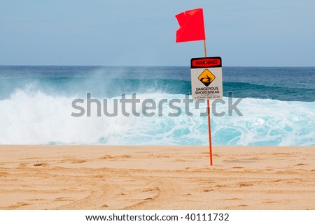 Warning signs mark where there is a very dangerous shore break and rip current along the north shore of Oahu Hawaii.