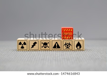Warning signs to be aware of dangers during work on wooden blocks.
