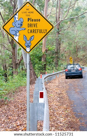 Warning street sign and a car in Australia
