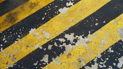 warning striped rectangular background, yellow and black stripes. old paint grunge . attention area diagonal stripes