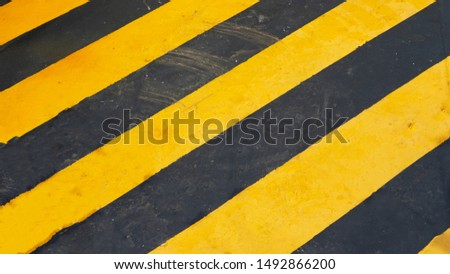 warning striped rectangular background, yellow and black stripes. old paint grunge . attention area diagonal stripes   #1492866200