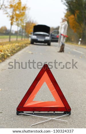 Warning triangle  placed in front of a car breakdown