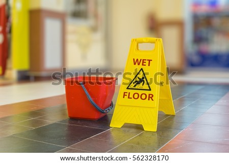 Warning yellow plastic sign of wet floor. #562328170