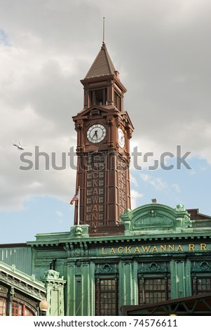 Warrington Plaza and clock tower of Hoboken terminal building