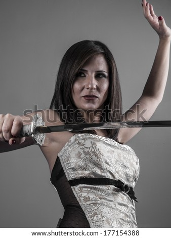 Stock Photo Warrior.Anime stylized brunette with short hair holding a katana sword with two hands