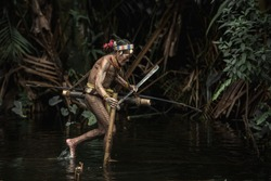 Warrior of Mentawai.The Indigenous inhabitants ethnic of the islands in Muara Siberut are also known as the Mentawai people. West Sumatra, Siberut island, Indonesia.