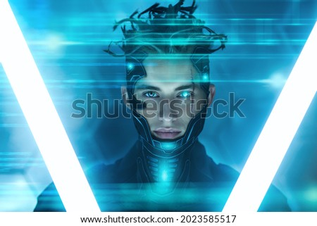 Warrior of the future. A brave cyberpunk warrior in protective uniform stands and looks at camera on alert in neon light. Game, virtual reality.