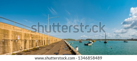 Warrnambool Breakwater and fishing boats moored in harbour, Warrnambool, Shipwreck Coast, Great Ocean Road, Victoria, Australia.