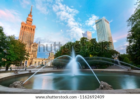 Warsaw and View of Palace of Culture and sciences (one of the main travel attractions - The Main symbol of Warsaw) with Fountain Close Up  #1162692409