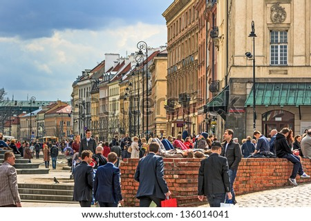 """WARSAW - APRIL 13: Castle Square marked out in the years 1818-1821, in towards the outlet to """"??Trakt Krolewski""""?��, meeting place for citizens and tourists in Warsaw, Poland on April 13, 2013"""
