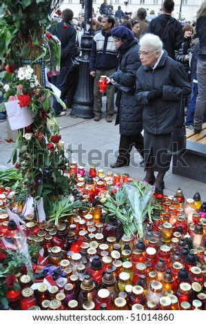 WARSAW - APRIL 11: People gathered outside the presidential palace, to remember the victims of the plane crash that killed Poland's president, Lech Kaczynski. April 11, 2010 in Warsaw, Poland.