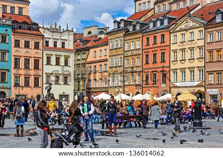 WARSAW - April 13: Unidentified tourists on the market of the Old Town which was completely destroyed during the World War II and rebuilt in the years 1949-1953 in Warsaw, Poland  on April 13, 2013