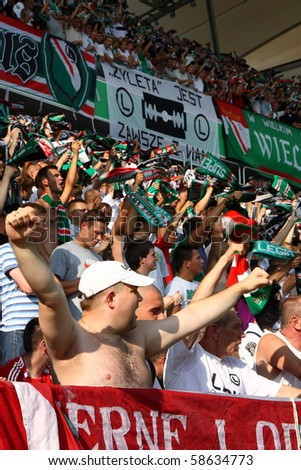 WARSAW - AUGUST 7 : Football fans in Legia Warsaw New Stadium during the friendly match between Legia Warsaw and Arsenal London on August 7, 2010 in Warsaw, Poland.