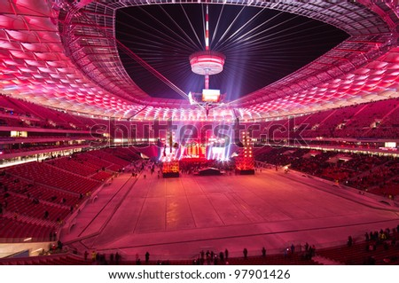WARSAW - JANUARY 29: Visitors at the grandstand, during The Grand Open Day at the National Stadium and a performance by the Polish band Lady Pank on January 29, 2012 in Warsaw, Poland.