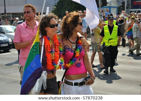 WARSAW - JULY 17: Participants of the EuroPride Parade, demonstrate  solidarity with the movement of the LGBT - lesbian, gay, bisexual and transgender rights on July 17, 2010 in Warsaw, Poland.