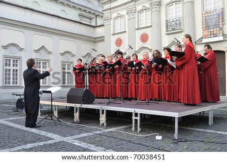 WARSAW - JUNE 28: The Choir of Singing Society from Saska Kepa sing during the concert in the court of the Warsaw Royal Castle on June 28, 2009 in Warsaw, Poland. Artur Backiel conducts the choir.