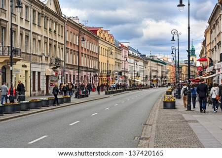 WARSAW - MAY 04: Nowy Swiat street , the name of which exist since the mid-eighteenth century, one of the most expensive and the most elegant streets in Warsaw in Poland on May 04, 2013