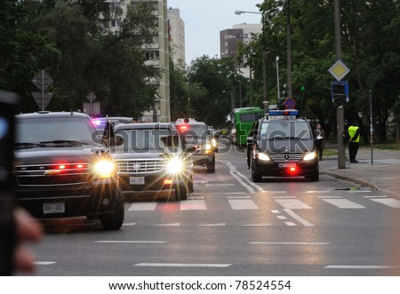 WARSAW - MAY 27: Presidential motorcade transporting U.S. President Barack Obama in Warsaw streets on May 27, 2011 in Warsaw, Poland. - stock photo