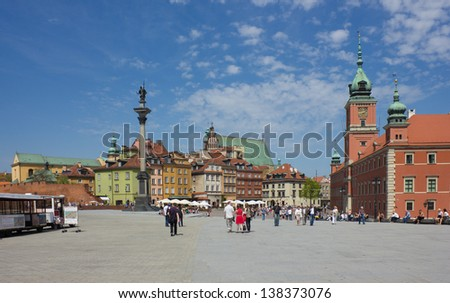 WARSAW - MAY 8: Sigismund's Column, Castle Square filled with tourists in the Old Town destroyed during World War II, rebuilt in the years 1949-1958 in Warsaw, Poland on May 8, 2013