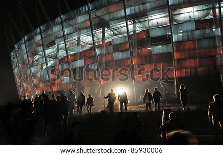 WARSAW - OCTOBER 02: Trial illumination of the facade, during The Grand Open Day at the National Stadium on October 02, 2011 in Warsaw, Poland.