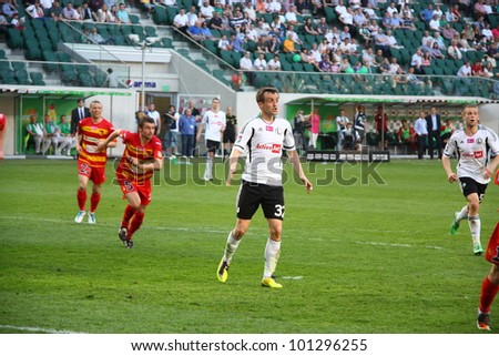 WARSAW, POLAND - APRIL 29: Miroslav Radovic in action (Legia) during the league football match between Legia Warsaw vs Jagiellonia Bialystok on April 29, 2012 in Warsaw, Poland. Final results: 1:1
